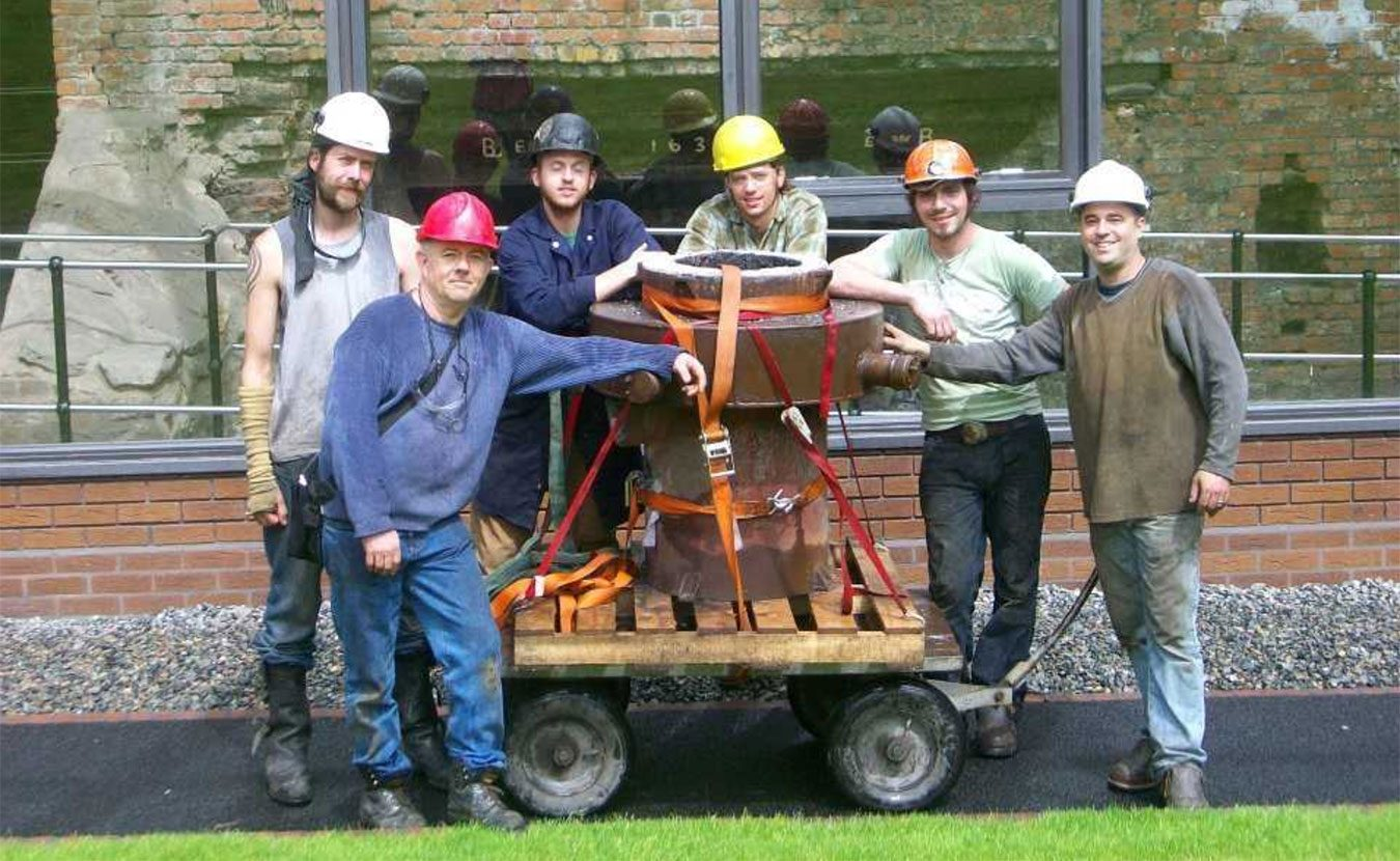 Iron casting crew in front of the historic Telford furnace in Coalbrookdale, England, at the International Conference of Contemporary Cast Iron Art 2009. From left, Chris Johns, Rick Batten, Will Vannerson, Nate Hensley, Chris Gerber, and Gerry Masse. The crew stands with Lady Dianne, the furnace they built, now in use at Sculpture Trails Outdoor Museum in Solsberry.   Courtesy photo