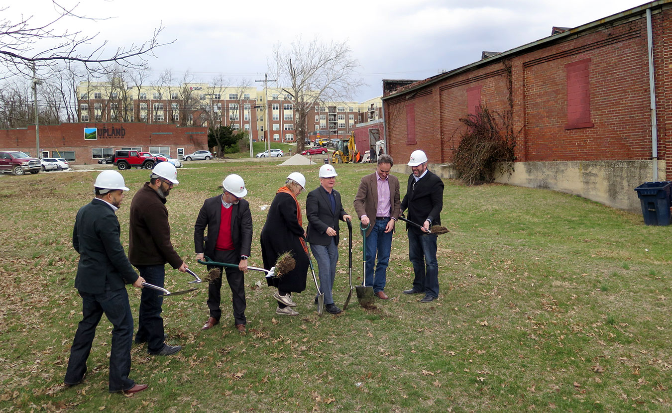 The groundbreaking ceremony on March 6 for the first phase of the Dimension Mill and Trades District; the original Dimension Mill is the building to the far right in the background. Breaking ground (l-r) are: Don Griffin, president, Bloomington Redevelopment Commission; Pat East; Craig McCormick, principal, Blackline Studio; Jane Martin, board president, Dimension Mill, Inc.; Mayor John Hamilton; Alex Crowley, director, Economic and Sustainable Development, City of Bloomington; and Jon Bohlander, principal, Anderson Bohlander. | Limestone Post