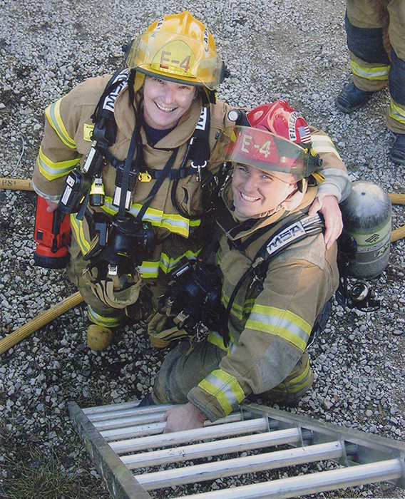 "Jean Magrane (left), who became Bloomington's first woman firefighter in 1987, with Greg Lucas at the ""Jiffy Treat training day"" in 2006. The fire department is often allowed to use condemned buildings for training purposes before the buildings are destroyed, such as the old Jiffy Treat on East Kirkwood Avenue. 