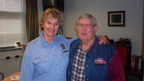 Magrane stands with her original capitan (who later became battalion chief), Bill Headley, on her retirement day. | Courtesy photo