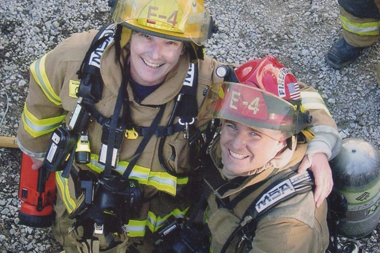 """Jean Magrane (left), who became Bloomington's first woman firefighter in 1987, with Greg Lucas at the """"Jiffy Treat training day"""" in 2006. The fire department is often allowed to use condemned buildings for training purposes before the buildings are destroyed, such as the old Jiffy Treat on Kirkwood Avenue.   Courtesy photo"""