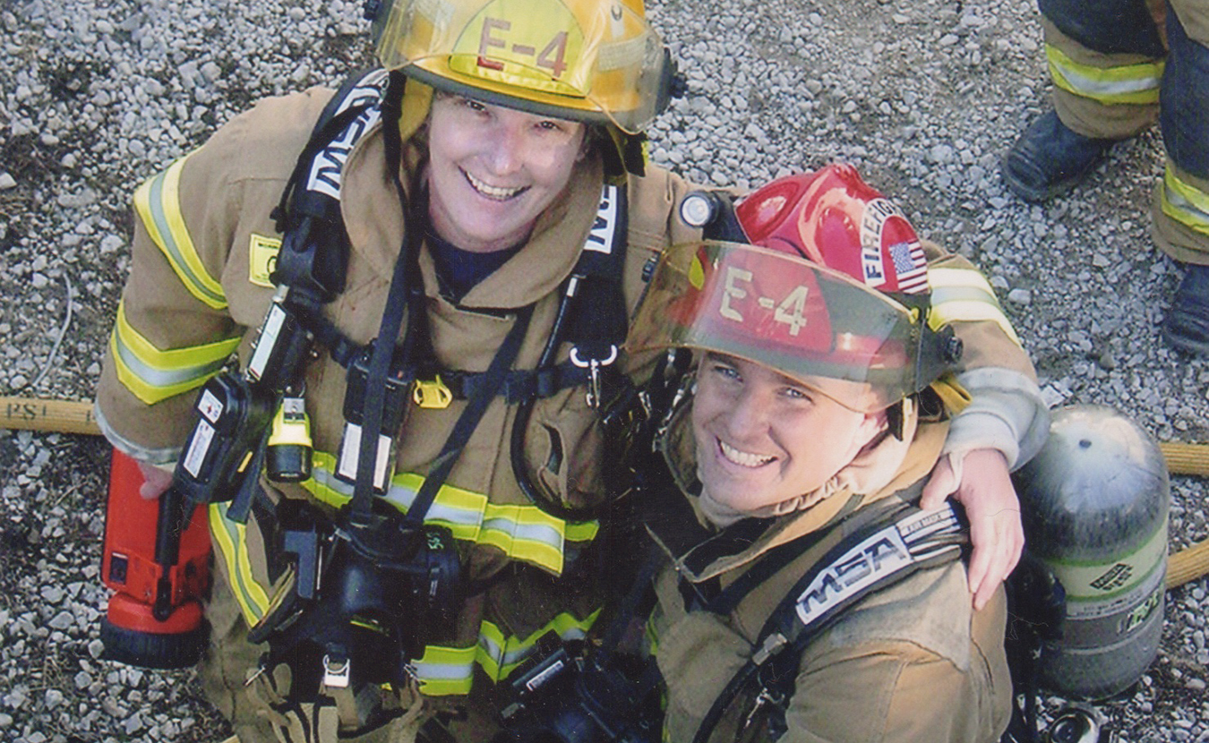 """Jean Magrane (left), who became Bloomington's first woman firefighter in 1987, with Greg Lucas at the """"Jiffy Treat training day"""" in 2006. The fire department is often allowed to use condemned buildings for training purposes before the buildings are destroyed, such as the old Jiffy Treat on Kirkwood Avenue. 