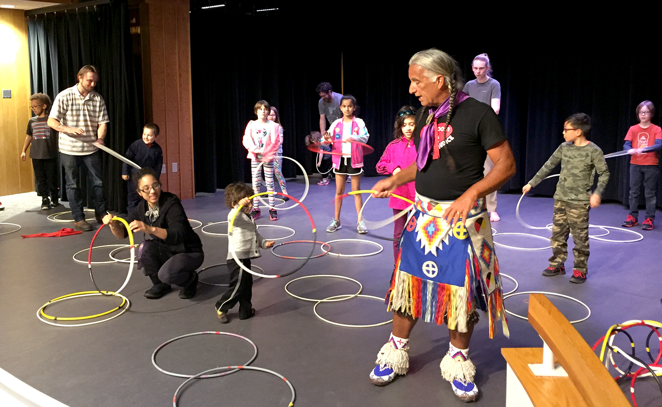 Kevin Locke, foreground, teaches local kids about Hoop Dance at the Monroe County Public Library this spring. (See the end of this story for a video of Locke performing a Hoop Dance.) | Limestone Post