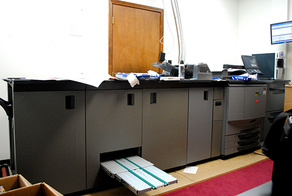 A large printing rig sits in a back room of TLC's offices. This rig is primarily used for printing booklets in a variety of indigenous languages. | Photo by Nicole McPheeters