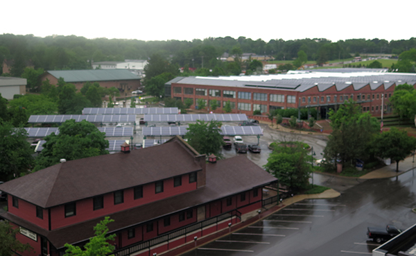 Installing solar panels in parking lots, such as at Showers Commons (pictured here), and on the roofs of buildings would allow the university to have enough solar energy to meet a large portion of its energy load without the need for any new real estate, says Flaherty. | Limestone Post