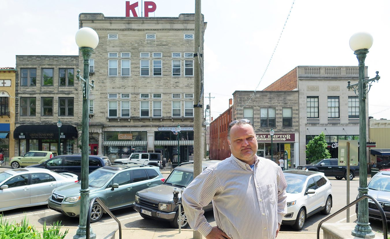 A family project of photographing Bloomington's history became a mission for Derek Richey (pictured here on the east side of the downtown Square) to preserve its past. Now he works with a fervor to preserve the houses that give our community so much character.   Limestone Post