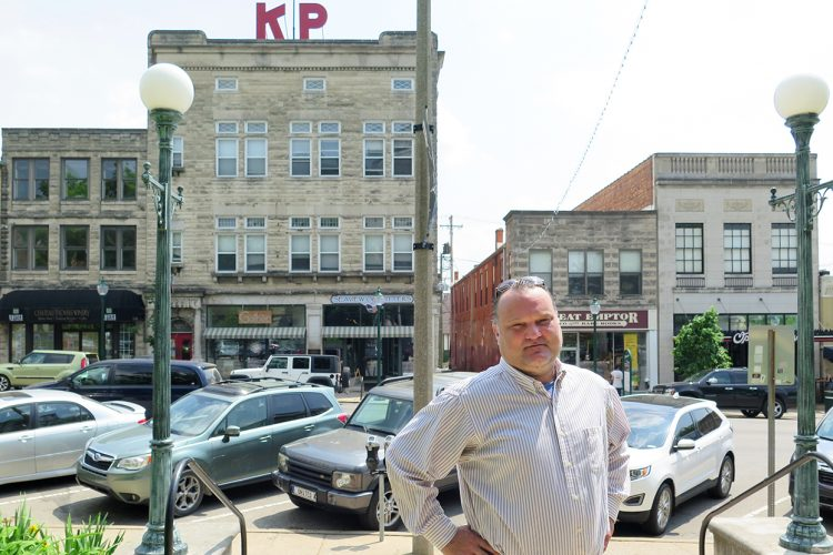 A family project of photographing Bloomington's history became a mission for Derek Richey (pictured here on the east side of the downtown Square) to preserve its past. Now he works with a fervor to preserve the houses that give our community so much character. | Limestone Post