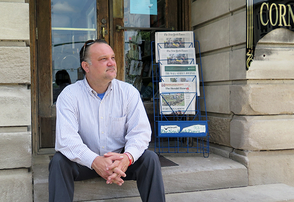 Richey sits on the steps of The Book Corner, which resides in a historic building on the east side of the downtown Square. | Limestone Post