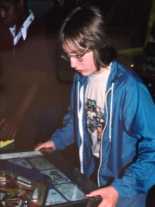 "Johnson, playing pinball in the late 1970s, at about the age he caught a bus to Ontario, by himself, ""to live off the land."" 