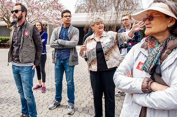 Shirley Bozell, center, leads a tour group at the Miller House. | Photo by Adam Reynolds