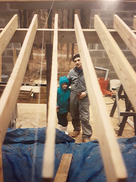 Lana Cruce with her father, as he builds the family home at May Creek Farm in the late 1980s. | Courtesy photo