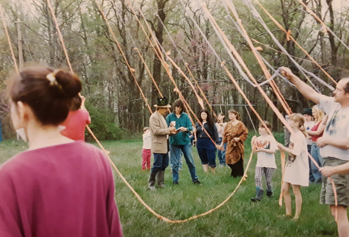 Members of May Creek Farm celebrate May Day with a maypole. | Courtesy photo