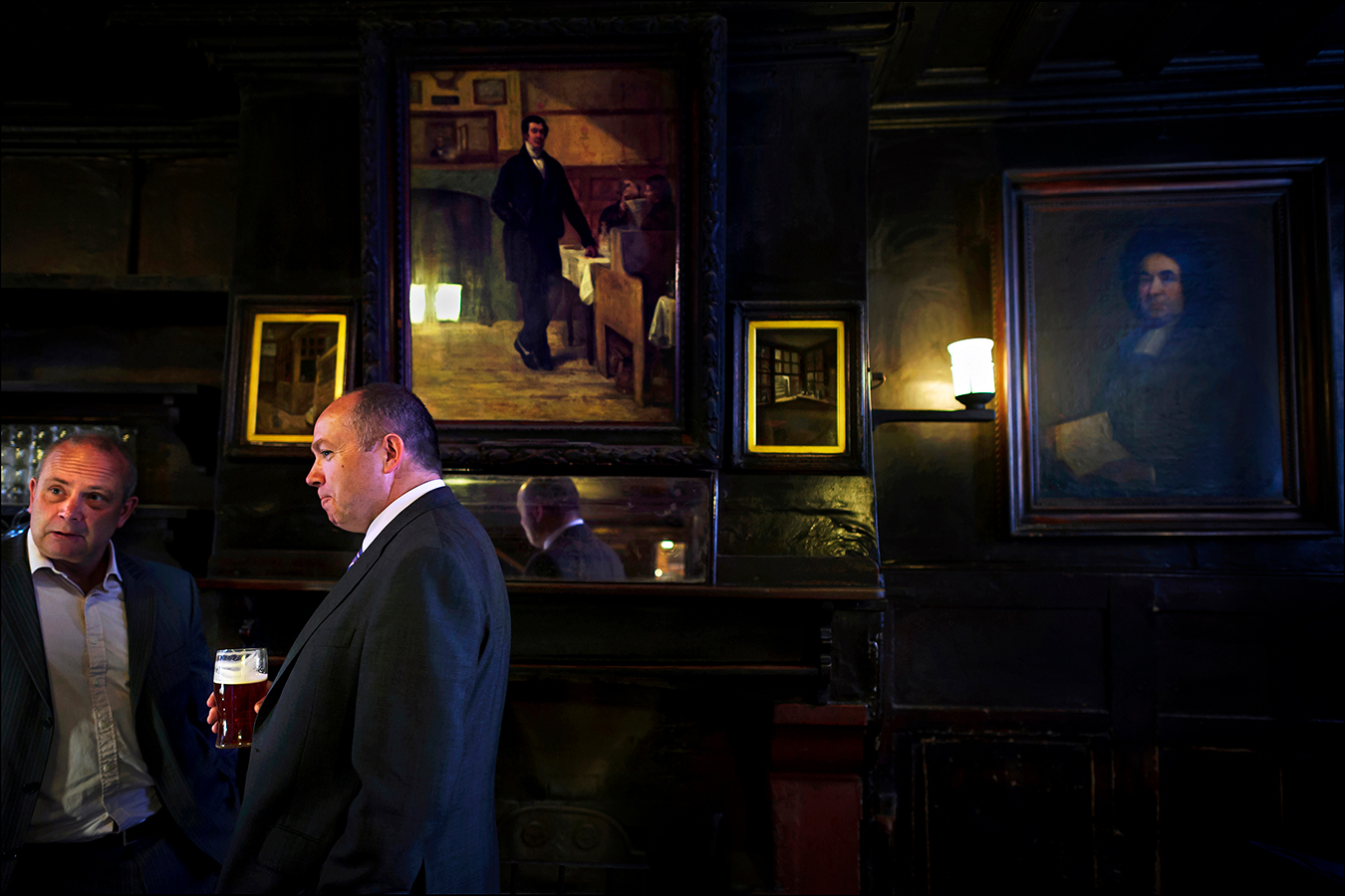 "A white-collar crowd mingles with tourists at Ye Olde Cheshire Cheese, which survived the Great Fire of London in 1666. Locals say the pub's lack of natural lighting generates a gloomy charm, something that appealed to authors such as Charles Dickens, Mark Twain, Alfred Tennyson, Sir Arthur Conan Doyle, and G. K. Chesterton, who were all regulars. The pub is alluded to in Dickens's ""A Tale of Two Cities"" as a haunt where a gentleman could recoup ""his strength with a good plain dinner and good wine."" 