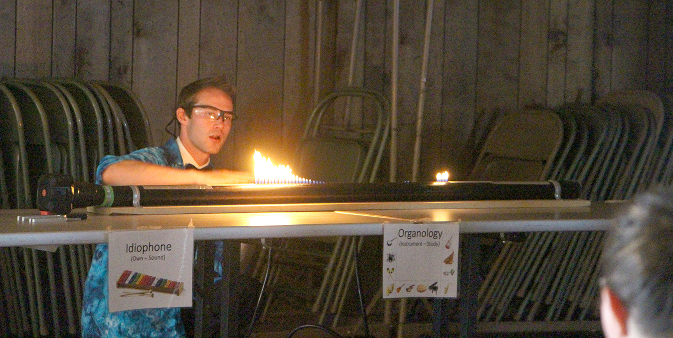 "Whites demonstrated the physics of sound waves using a ""Reuben's tube"" of flames. 