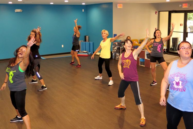 Writer Jennifer Pacenza, pictured far right at a Bollywood dance class, spoke with experts who say a body-positive fitness model is more important for achieving physical and mental well-being than exercise regimens promoted by fitness and weight-loss industries. Pacenza says it's important to find a way that you love to move your body. | Limestone Post