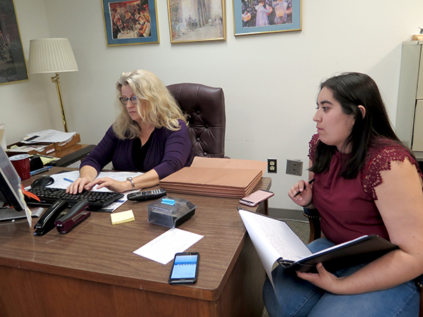 Diane Walker, executive director of District 10 Pro Bono Project, works at her desk with Alexxis Lara, a law student intern. | Limestone Post