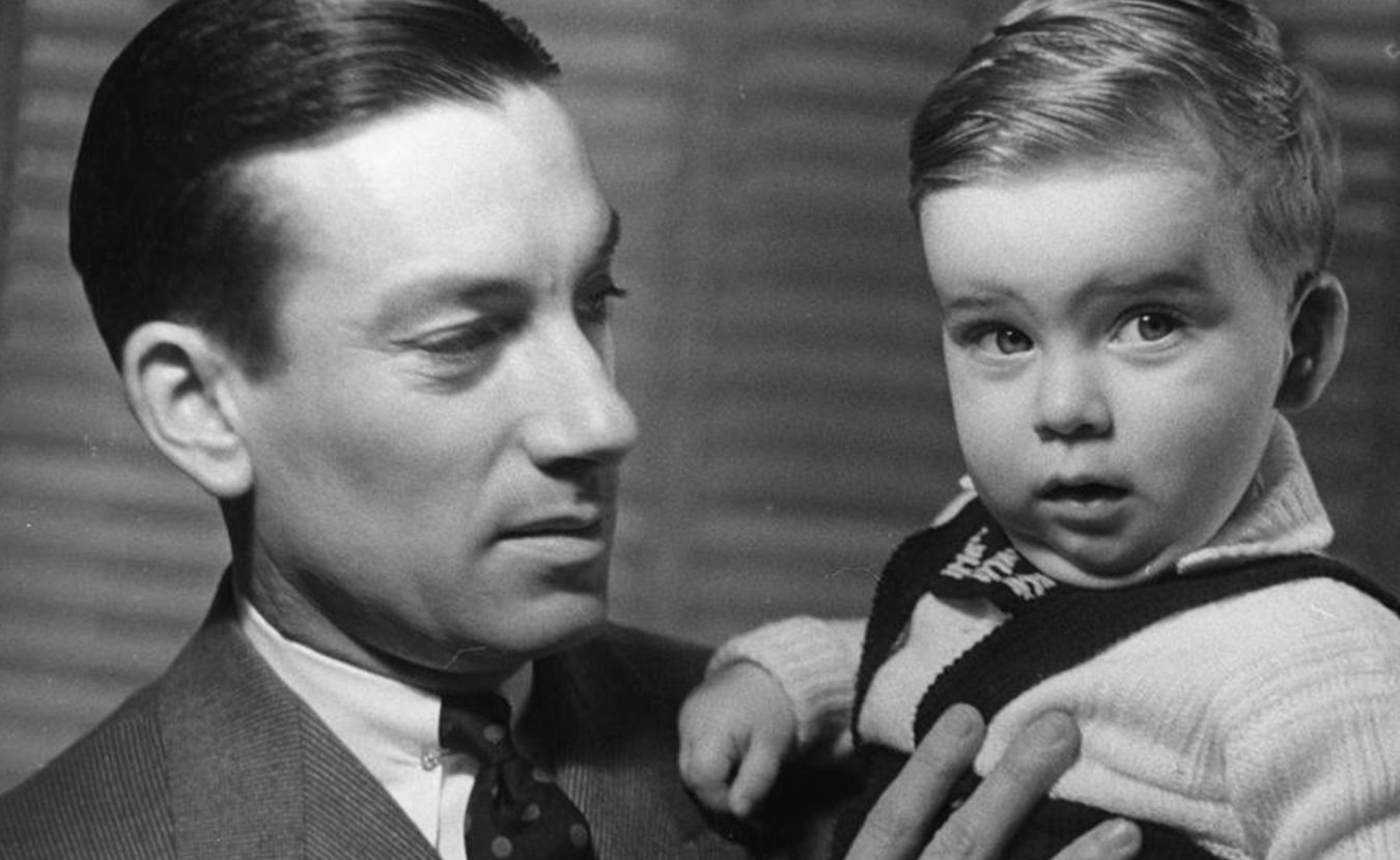 """Hoagy Carmichael holds son Hoagy Bix in the early 1940s. More recently, Hoagy Bix was in town for IU Theatre's production of """"Stardust Road: A Hoagy Carmichael Musical Journey,"""" and he talked with writer Michael G. Glab about growing up in Hollywood, his famous namesakes (Hoagy and Bix), and the musical that is premiering in Bloomington.   HC Series 3, Box 3, item 33. Hoagy Carmichael Collection, Archives of Traditional Music, Indiana University"""
