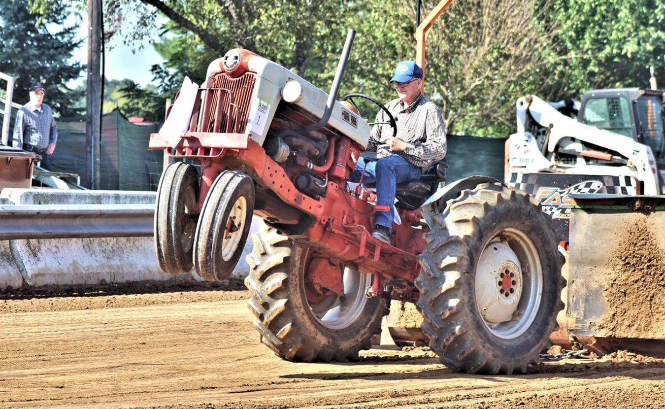 If you're looking to escape the weekend crowds this month, two massive festivals in two tiny towns might just be the ticket. The White River Valley Antique Show and the Lanesville Heritage Weekend are chockfull of authentic Hoosier heritage and late-summer fun. The antique tractor pull, pictured here in Lanesville, is a popular event. | Photo courtesy of the Lanesville Heritage Society