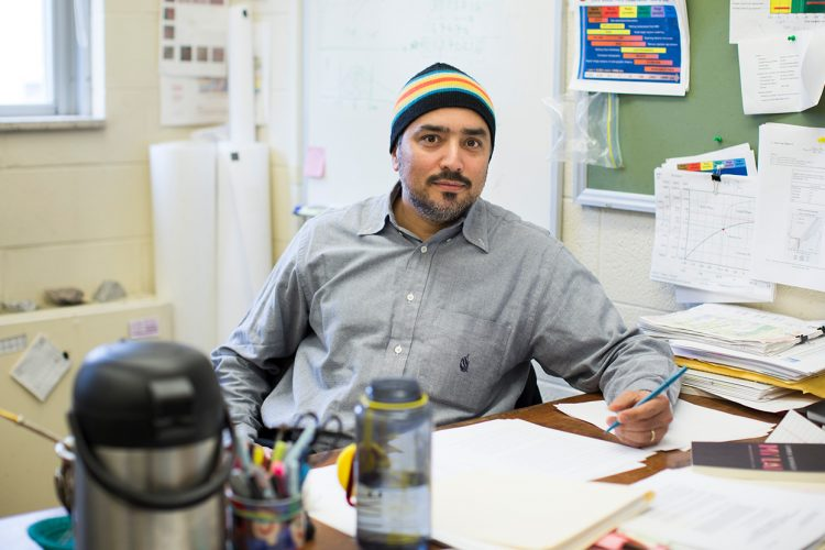Cristian Medina, a poet, cook, IU researcher, and chess leader from Arica, Chile, moved to Bloomington in the mid-2000s. Pictured here, Medina sits at his desk at the Indiana Geological and Water Survey. | Photo by Chaz Mottinger