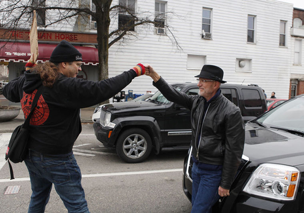 "Joe Varga, left, during a Black Lives Matter disruption on College Avenue in 2014. He says, ""A motorist shut off his vehicle and joined our blockade, and gave me this fist bump."" 