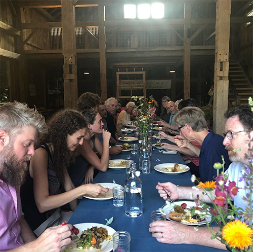 Many local small farms focus on creating community, such as CSA potluck nights at Sobremesa Farm, pictured here. | Courtesy photo