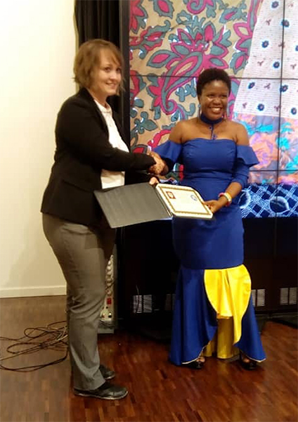 Eastina receives her certificate during the 2018 Mandela Washington Fellowship graduation ceremony. | Courtesy photo