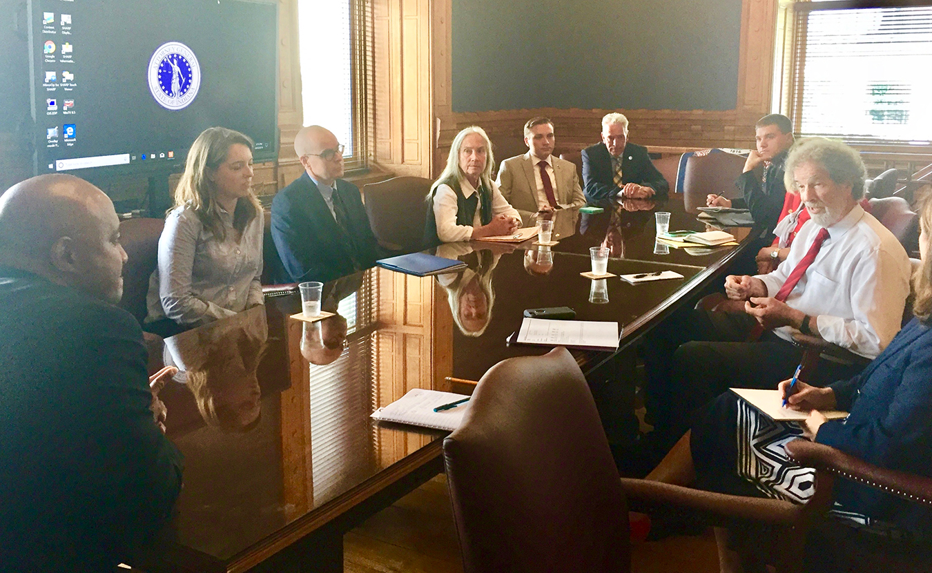 Stone, right, and a number of other healthcare activists met with Indiana Attorney General Curtis Hill Jr., left, in August to discuss the protection of the Affordable Care Act and The Healthy Indiana Plan. | Courtesy photo