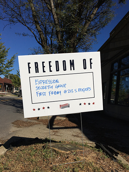"The For Freedoms event at Secretly Group featured various artists' works with the common theme ""On Fear,"" along with an opportunity for attendees to register to vote. In early October, yard signs were distributed to interested citizens with ""Freedom Of"" and ""Freedom From"" printed on them, along with a blank space for recipients to fill in. More yard signs will be available at the panel discussion and can be picked up at the Economic and Sustainable Development office in City Hall until supplies run out."