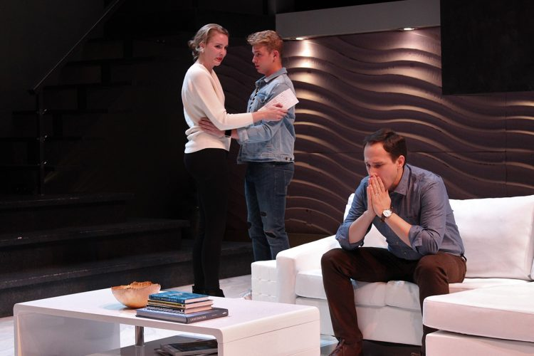 """'The Goat, or Who is Sylvia?' is """"a difficult play for both directors and actors,"""" writes LP's performance columnist Jennifer Pacenza. But IU's production of this Tony Award-winning play by Edward Albee is also """"emotional but liberating,"""" one that will give audiences """"a flurry of emotions — love, betrayal, disgust, pity, and delight."""" In the play, a secret tears apart Martin Gray (played by Jay Hemphill, on couch) and his wife, Stevie (Glynnis Kunkel-Ruiz), and son, Billy (Josh Hogan) — """"a perfect American family."""" 