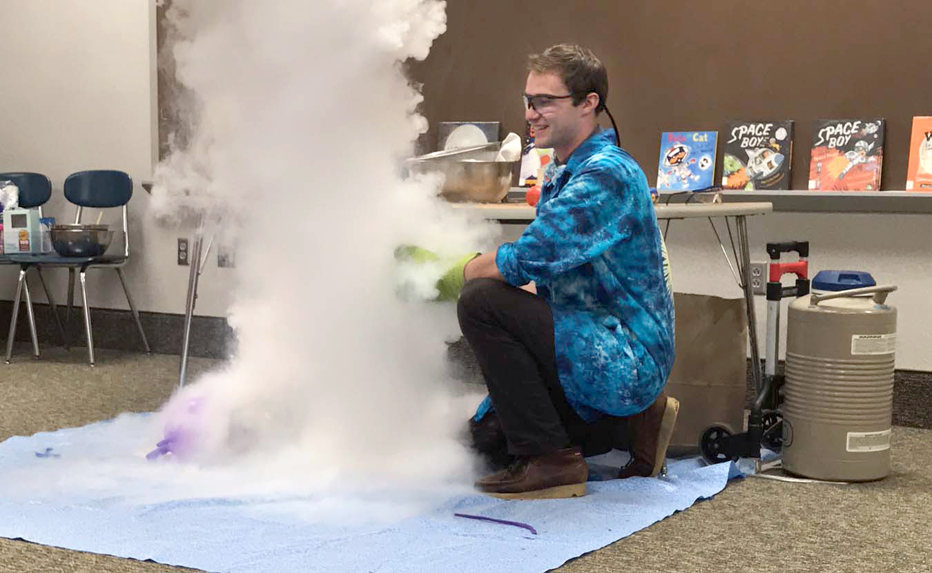 WonderLab's elementary education specialist, Nick Whites, performs a Cloud Making Experiment, one of dozens of experiments showcased during WonderLab's Interactive Science Shows through the museum's Outreach program.