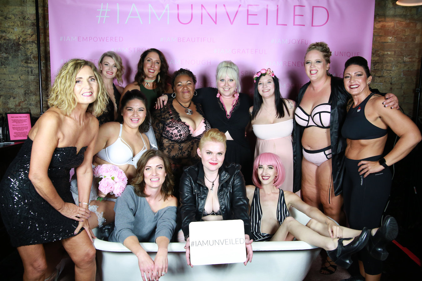 "The incredibly intimate experience of a boudoir photo shoot often turns into ""a sense of community and support"" for many UNVEILED clients. Samantha is in the back row, center. 