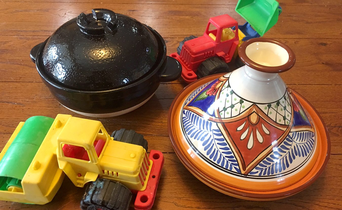 "Her grandson's fascination with dump trucks has helped Ruthie Cohen to up her game in the kitchen. Now she considers ""other methods and materials for cooking."" Led by ""a little child with his toy bulldozer in hand,"" she explores how a Japanese donabe, left, and a Tunisian tagine, right, can enrich your kitchen creations. 