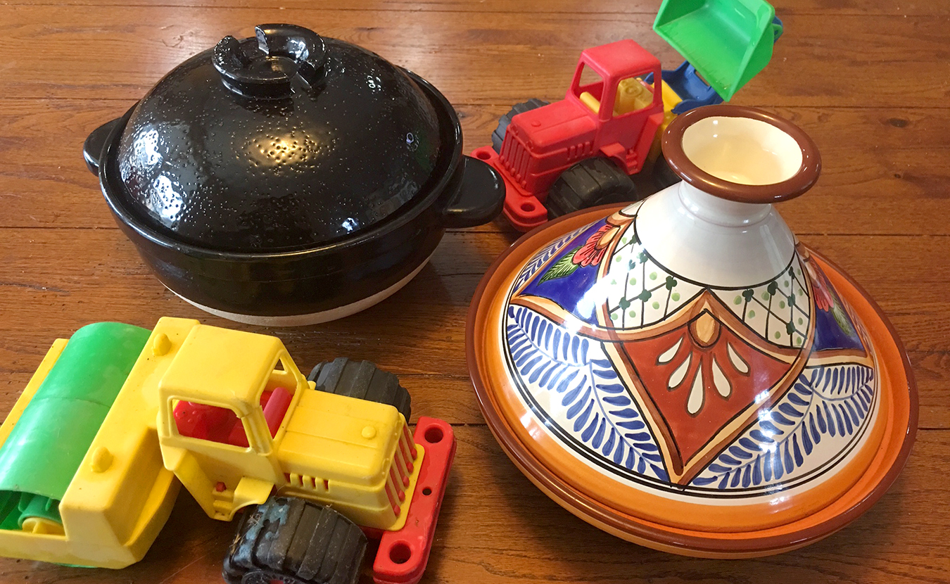 """Her grandson's fascination with dump trucks has helped Ruthie Cohen to up her game in the kitchen. Now she considers """"other methods and materials for cooking."""" Led by """"a little child with his toy bulldozer in hand,"""" she explores how a Japanese donabe, left, and a Tunisian tagine, right, can enrich your kitchen creations. 