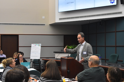 Alex Crowley speaking about the CDFI Friendly City during a BEAD Summit at City Hall | Photo by Katlin Suter