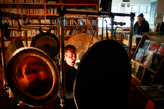 """Percussionist and composer Jon Mueller performed at Landlocked in March. This type of experience is """"the sort of thing that just wouldn't work very well in a bar or a club,"""" says Landlocked co-owner Heath Byers.   Photo by Jeremy Hogan"""