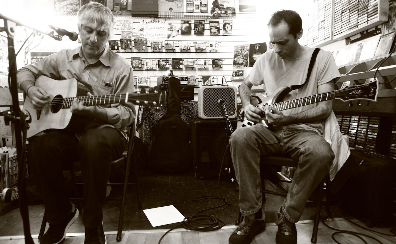 Lee Ranaldo (left) of Sonic Youth plays at Landlocked Music in 2012. Ranaldo also recited a poem about Bloomington that he had written in 1990. Landlocked has hosted about 50 in-store performances since it opened in 2006. | Photo by Jeremy Hogan