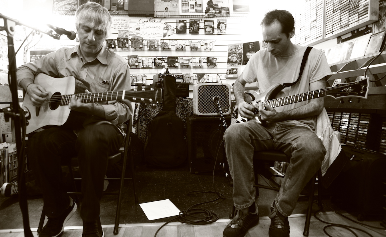 Landlocked Music has hosted about 50 in-store performances since it opened in 2006. Lee Ranaldo (left) of Sonic Youth and Alan Licht played at Landlocked in 2012. Ranaldo also recited a poem about Bloomington that he had written in 1991. | Photo by Jeremy Hogan