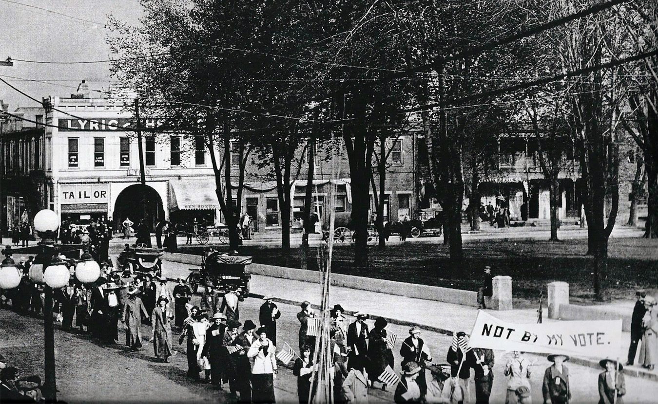 "Antoinette Leach was living in Sullivan County in 1893 when she became the first female lawyer in Indiana. While her law practice specializing in ""Commercial Law and Collections"" prospered, she was also active in politics, including local and national suffrage associations. This photo is of a suffrage parade in downtown Sullivan that Leach likely organized. 