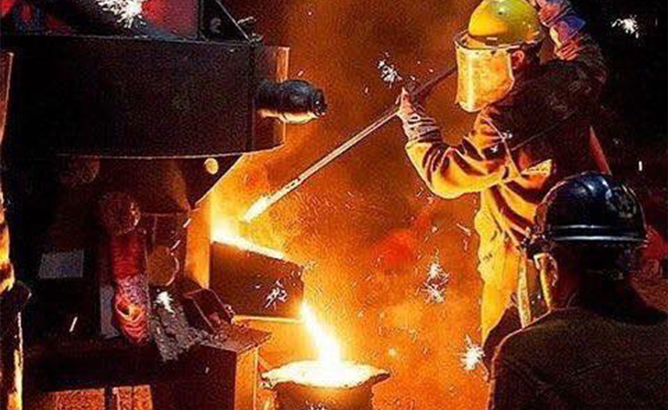 In July, Sculpture Trails Outdoor Museum holds its annual monthlong series of workshops and public events in Solsberry, capped by the Fire@Nite Iron Pour on July 27. (in yellow hardhat) Sculpture Trails founder Gerry Masse working the iron furnace at a previous event. | Courtesy photo