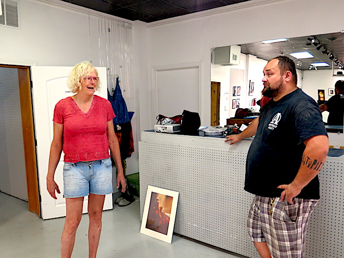 """Jeanne Smith (left) spoke with Nahas at Dimensions Gallery as she prepared for her show, """"Bikes to Boudoir — Gender Queer Transition to Tactile Expression,"""" a look at her life's work, which opened August 2. 