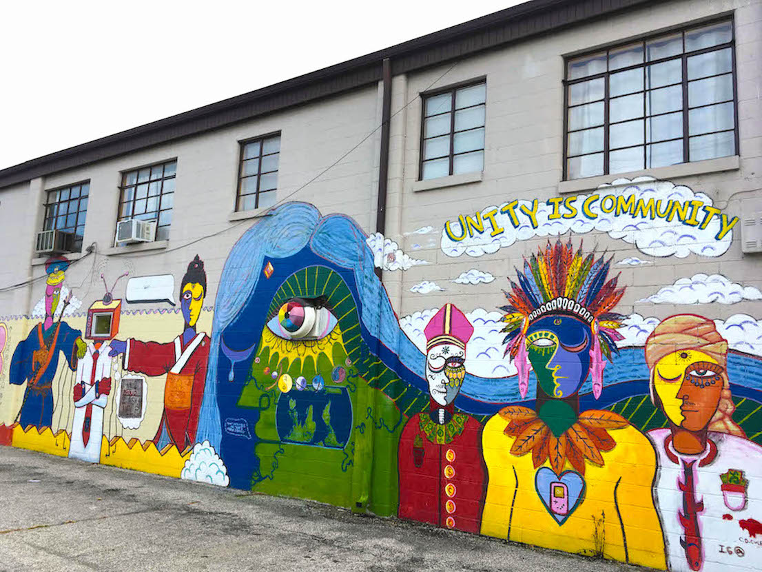 One of many on the Artisan Alley building painted from 2017-2019, 'Unity Is Community', 222 W. 2nd St., artist — C.D. Culpepper