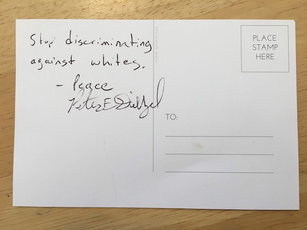 "This fall, the Purple Shirt Brigade handed out postcards at the Farmers' Market for people to write about how white supremacy in the market makes them feel. The cards would be sent to Mayor John Hamilton. This card was signed by 'Peter E Diezel.' In April, the <a href=""https://chicago.suntimes.com/2019/4/27/18623600/how-groups-tied-to-white-nationalists-are-targeting-chicago-and-kim-foxx"" target=""""_blank&quot;"">Chicago Sun-Times website</a> reported an Indiana man identified as Peter Diezel was associated with Identity Evropa and posted tweets defending Adolf Hitler. 