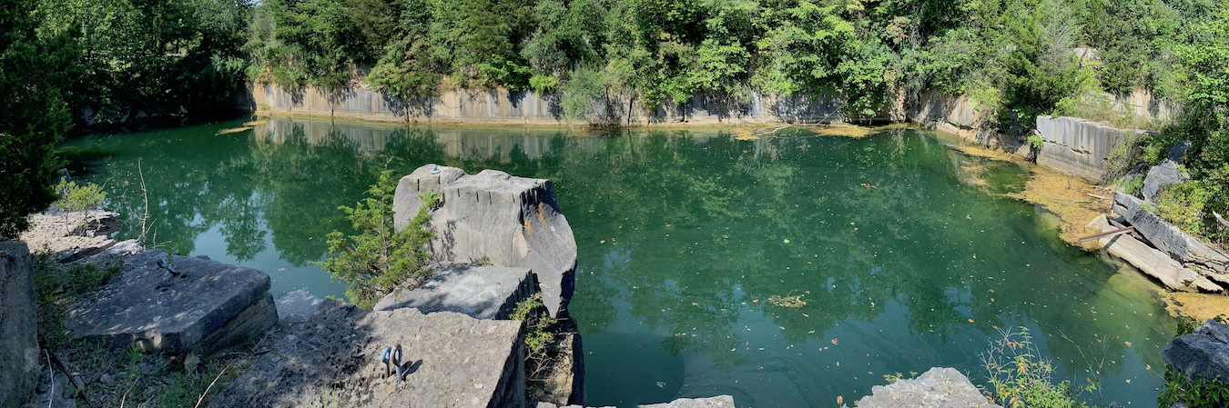 Longtime local residents have given some of the more popular quarries different names over the years. Before it was filled in, Rooftop was officially Adams Quarry but was also known as Sanders Quarry. The property being considered for a limestone heritage park includes two quarries that were favorite (if illegal) swimming holes for decades — Long Hole and Ice Box. This photo shows part of Long Hole, which was split in two when SR 46 was constructed. | Photo by Geoff McKim