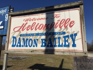 Billboard proclaiming that Heltonville is the proud home of Indiana high school basketball legend Damon Bailey. | Limestone Post