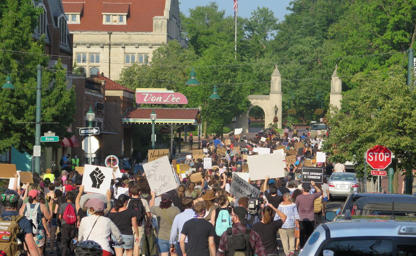 On two consecutive days in downtown Bloomington, protestors expressed outrage at the racial aggression, profiling, and anti-Black violence that residents have faced — recently, historically, and continually — in the community. Each protest was attended by hundreds of supporters, culminating in a march through the streets. | Photo by Limestone Post