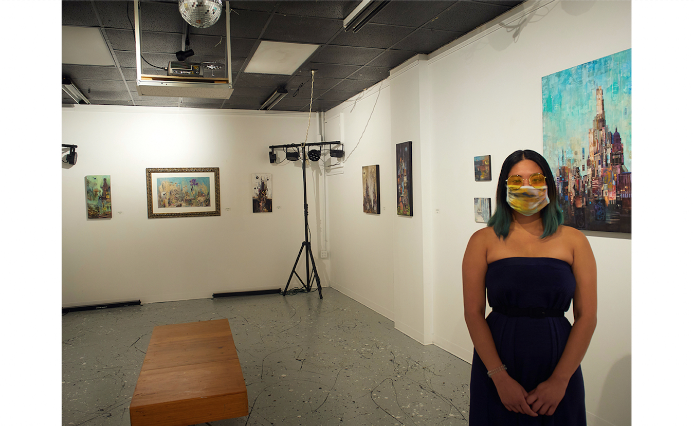 Diva Armas Luther, curator of Dimensions Gallery at Artisan Alley, says the gallery is offering online viewing of their artists' work and in-person viewing by appointment only. Artwork by Lydia Burris is currently on display. | Photo by Paige Strobel