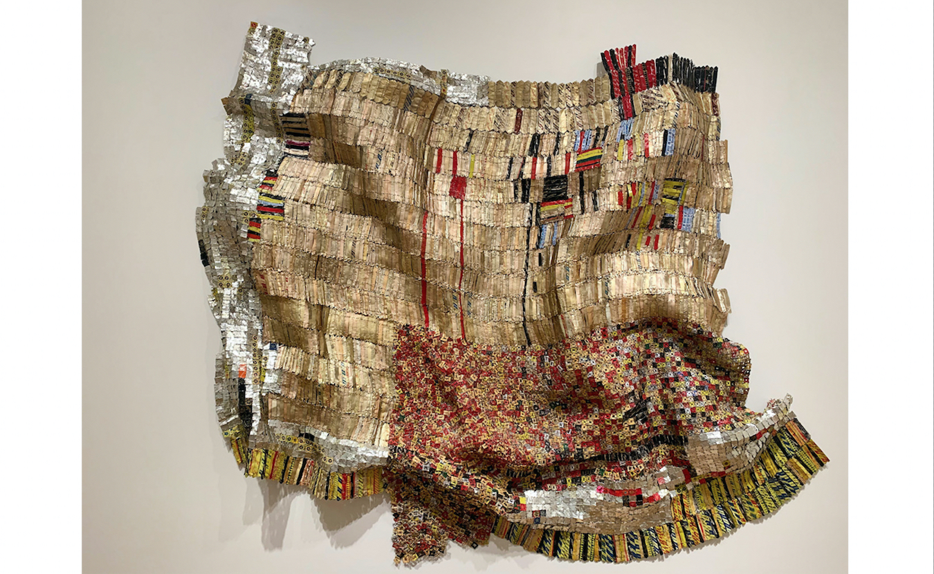 Another recent acquisition by the Eskenazi Museum of Art, Untitled, by El Anatsui, who has since spent much of his artistic career in Nigeria. Aluminum bottle caps and copper wire (2009). | Photo by Paige Strobel