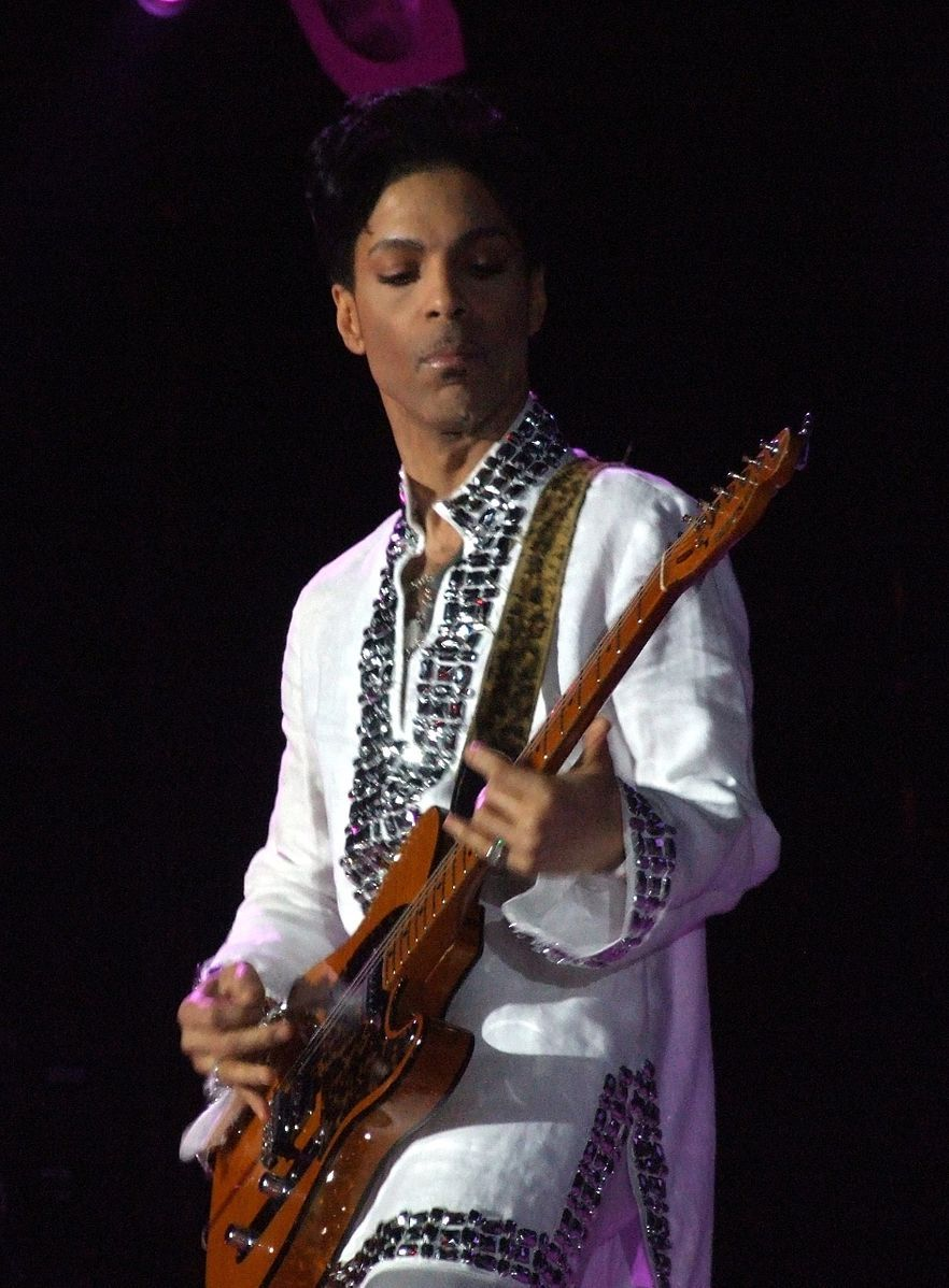"Prince, by <a href=""https://commons.wikimedia.org/wiki/File:Prince_at_Coachella_(cropped).jpg"">penner</a>, <a href=""https://creativecommons.org/licenses/by-sa/3.0"">CC BY-SA 3.0</a>, via Wikimedia Commons"