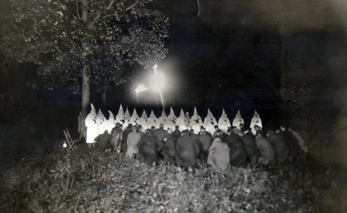 While the Ku Klux Klan in Indiana peaked nearly 100 years ago, its members' support of Christian nationalism is reflected in various political, militia, and hate groups today. Writer Laurie D. Borman interviewed several experts who suggest the ideologies espoused by today's far-right groups are a continuation of the country's racist past. This photo is of a KKK cross burning in northern Indiana in 1922.